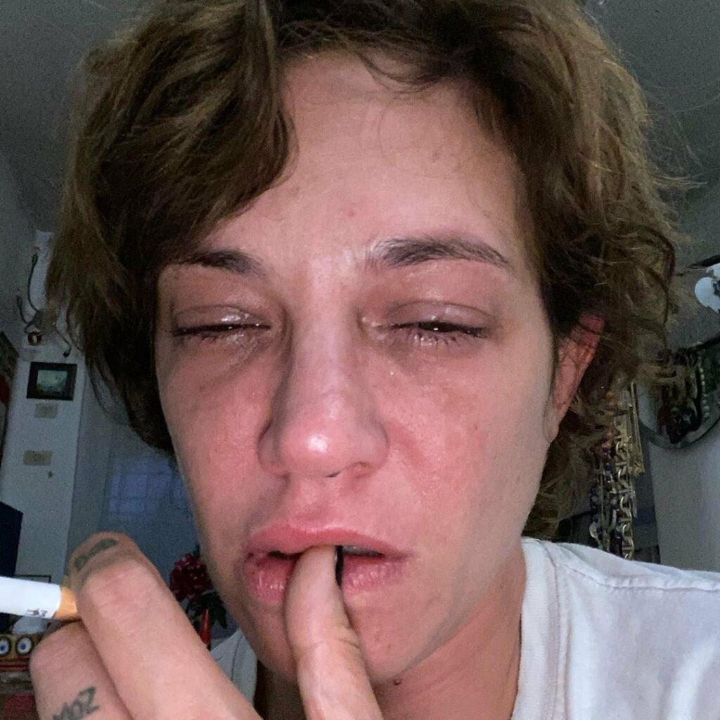 Asia Argento crying on the anniversary of Bourdain's death.