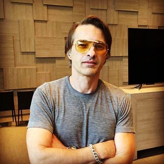 Olivier Martinez in yellow glasses