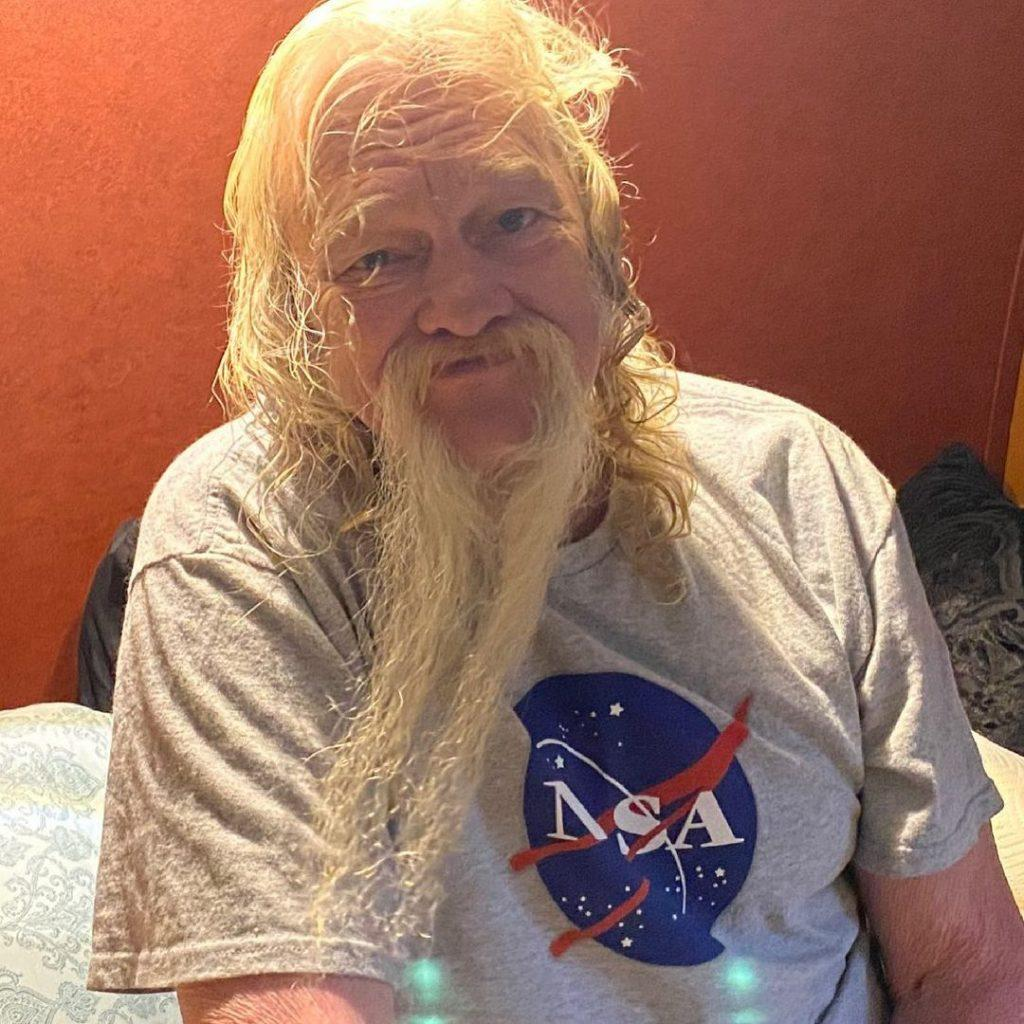 Billy Brown with a long white beard
