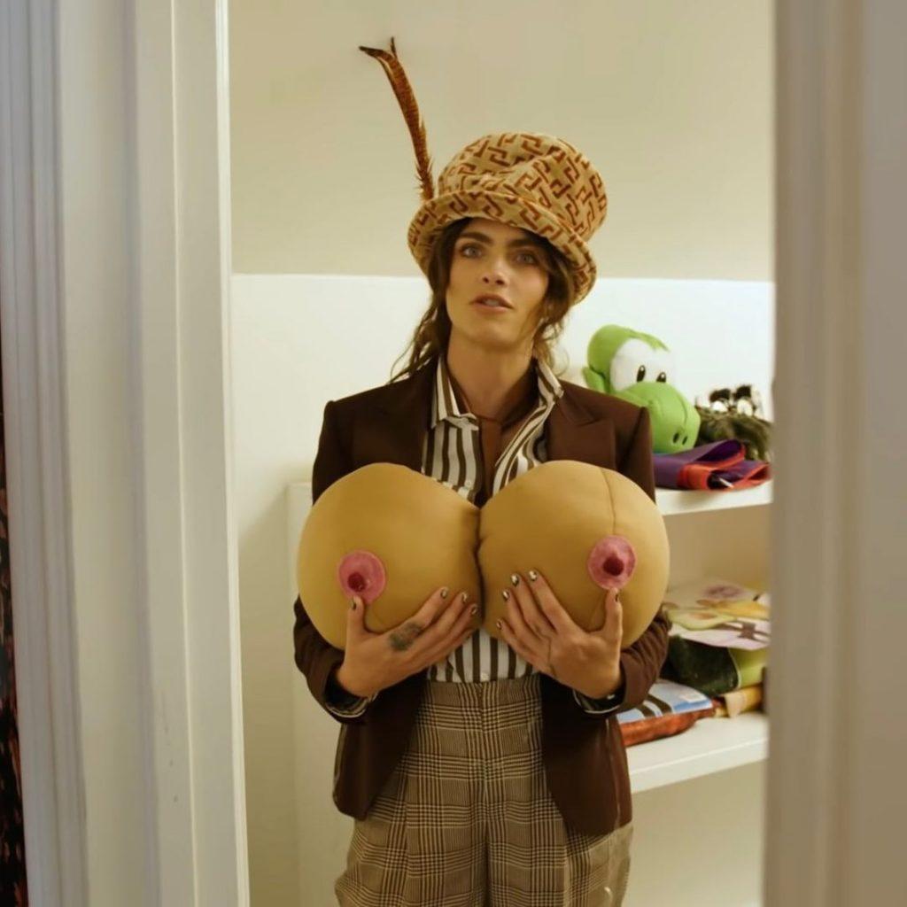 Cara Delevingne holding boob pillows