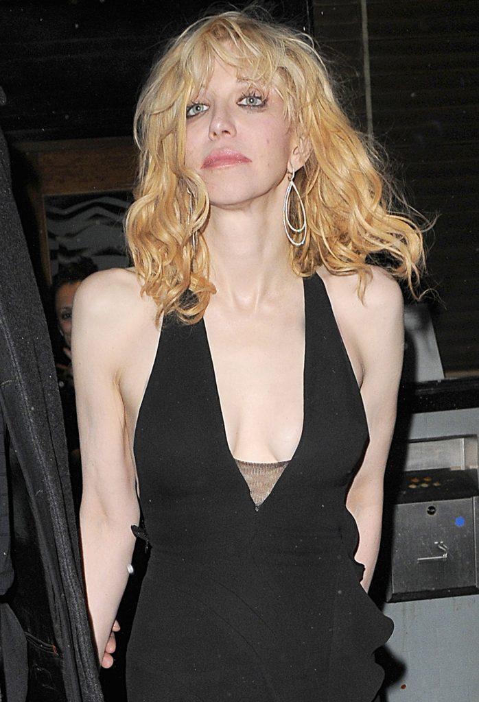 Courtney Love in a low cut black dress