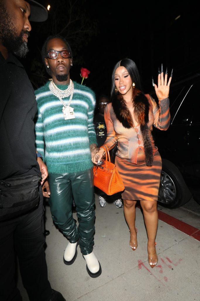 A pregnant Cardi B wears a leopard print dress as she and Offset head to BOA Steakhouse