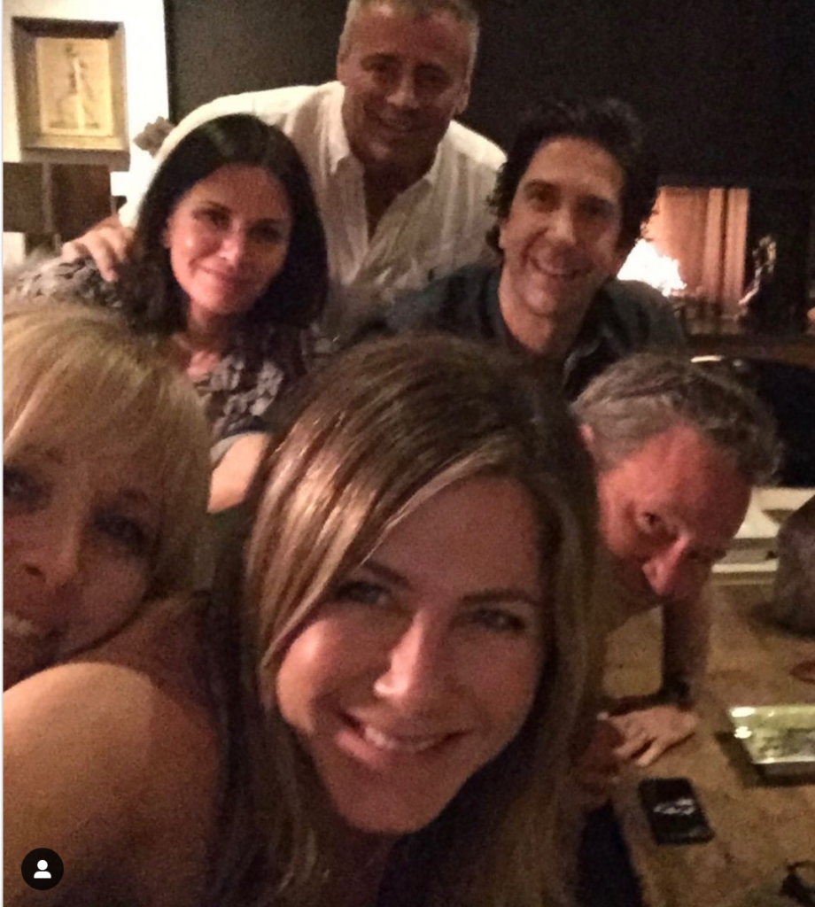 Jennifer Aniston taking a selfie with her Friends co-stars