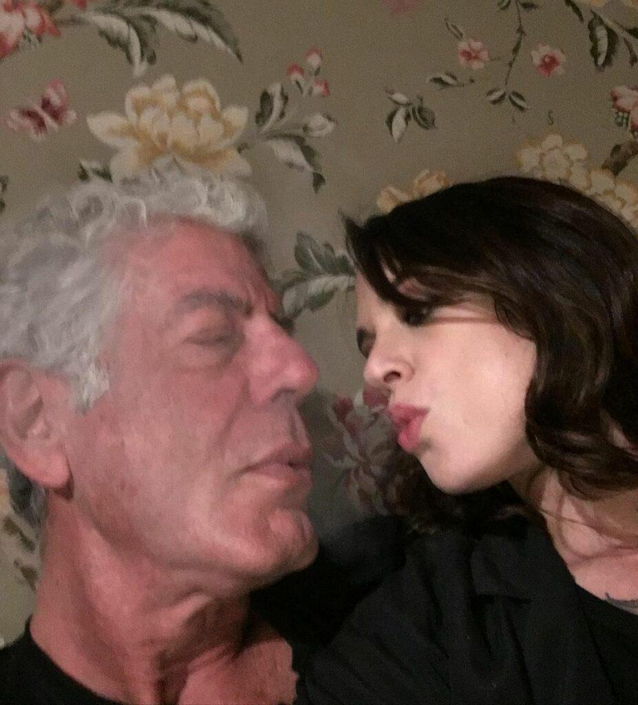 Asia Argento and Anthony Bourdain about to kiss.