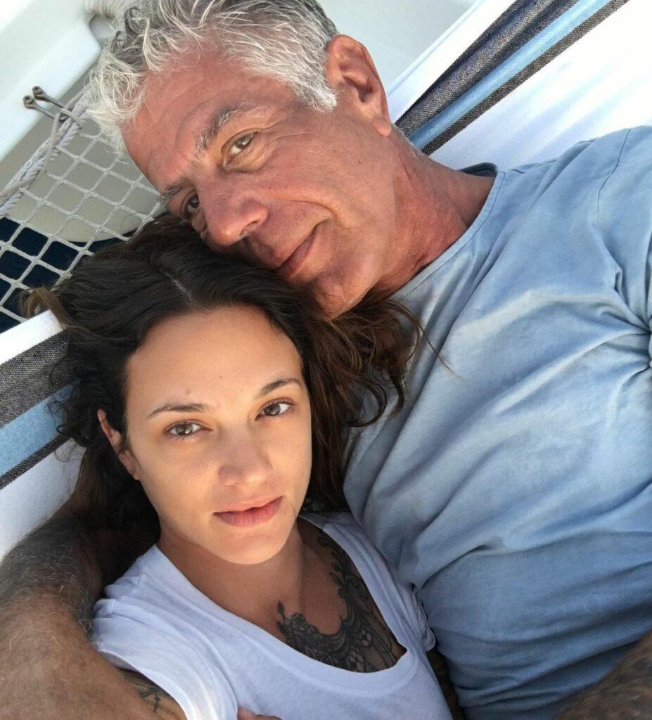 Asia Argento and Anthony Bourdain posing for a selfie.
