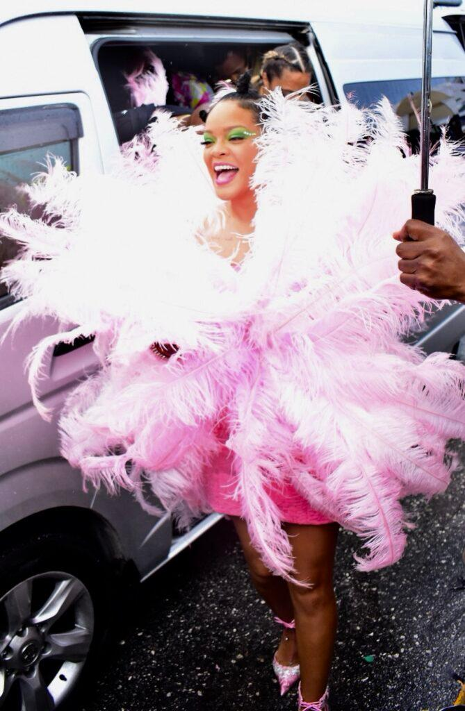 Rihanna sizzles in a pink costume at Barbados crop over festival with Prime Minister of Barbados Mia Mottley