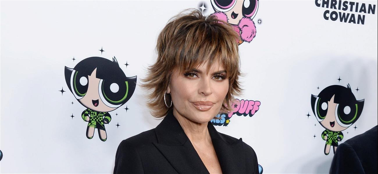Lisa Rinna Rocks A Plunging Dress To Promote Her New 'Lip Kit'