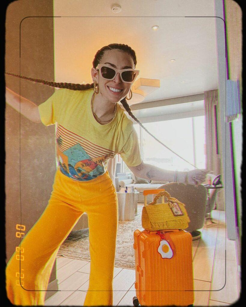 Rumer Willis in yellow and orange outfit