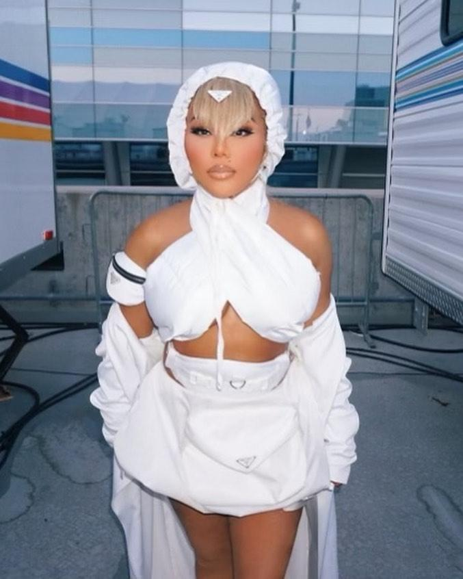 Lil' Kim in a white outfit