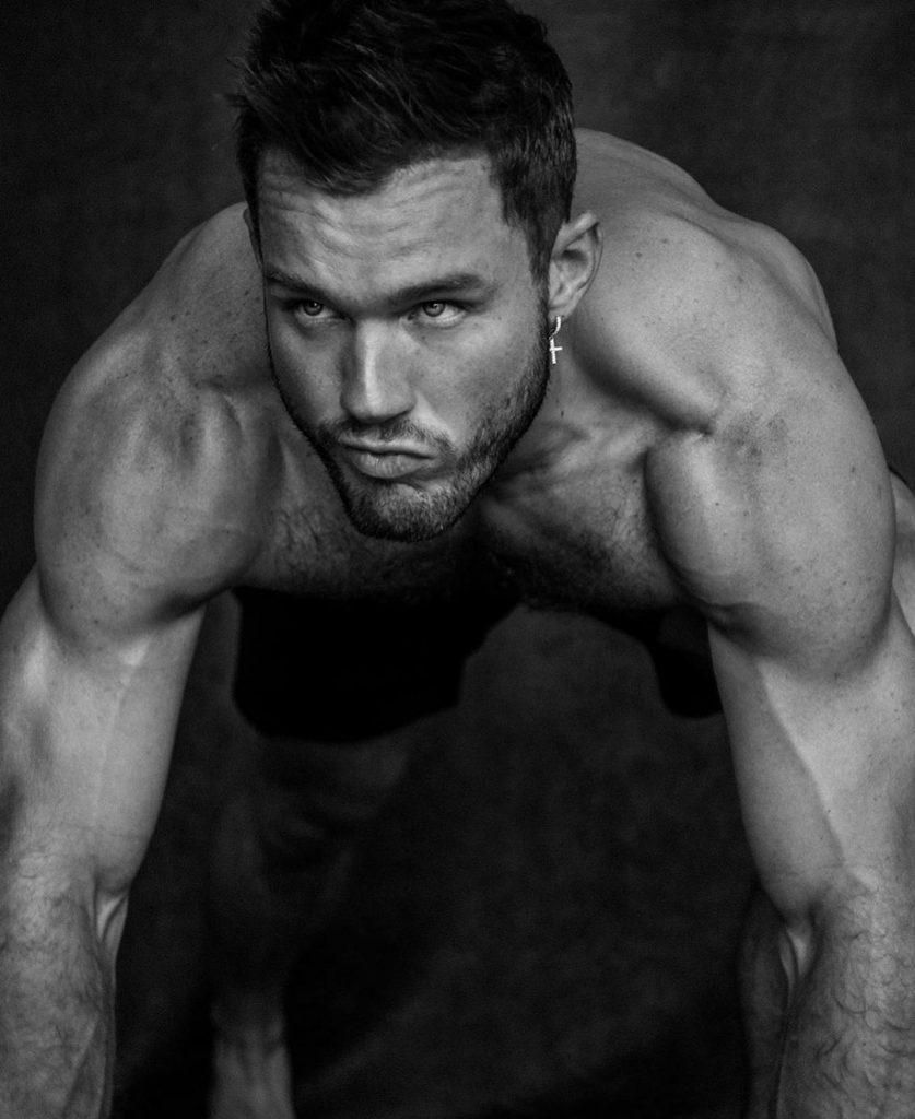 Colton Underwood in a pushup position