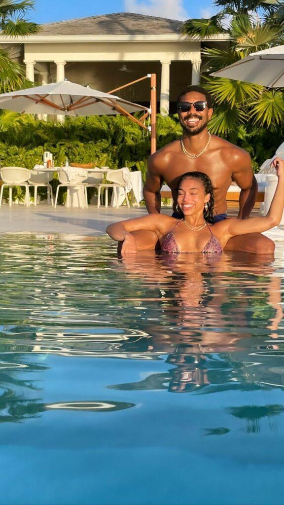 Lori Harvey and Michael B. Jordan in the pool.