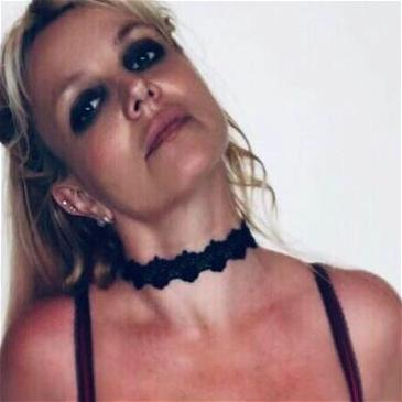 Britney Spears Flaunts Topless Shots Amid Family War