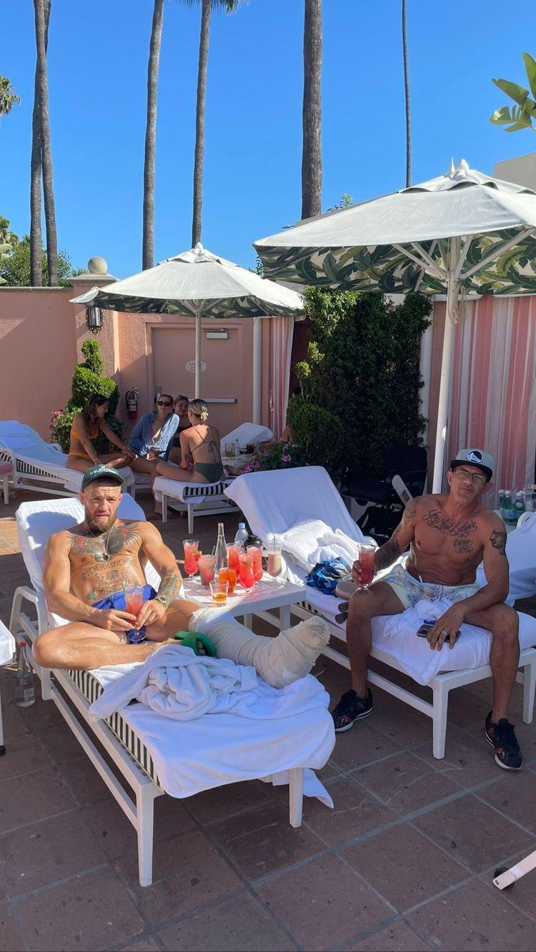 Conor McGregor Enjoys Cocktails By The Pool While Recovering From Leg Surgery