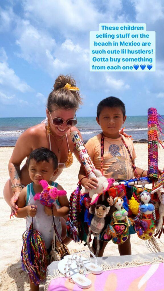 Chanel West Coast buying chachkies on the beach.
