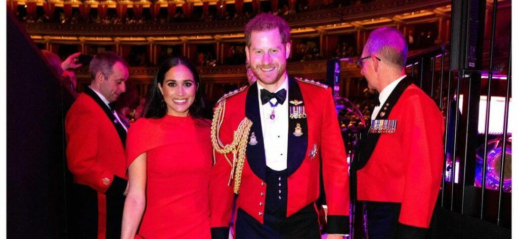 A throwback photo of Prince Harry and Meghan Markle sporting matching color outfits at an event.