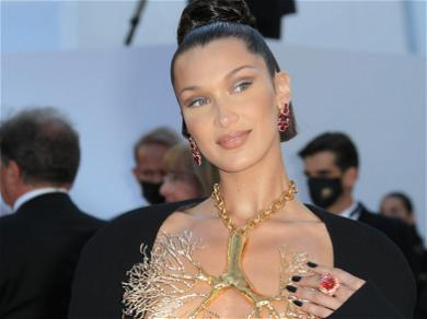 Bella Hadid Seeks Fan's Opinion Over New Bright Red Hair