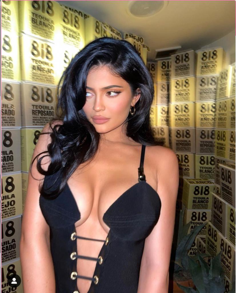 Kylie Jenner in a low cut dress