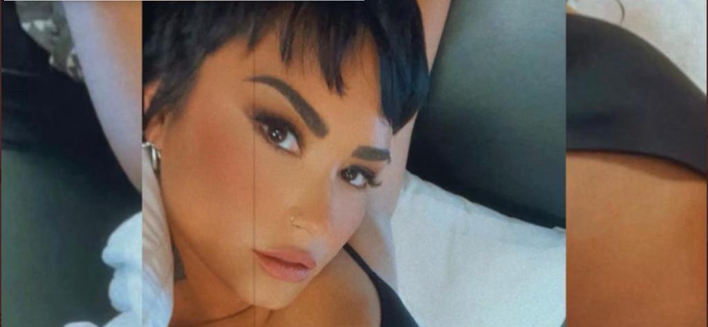 Demi Lovato wearing black lingerie