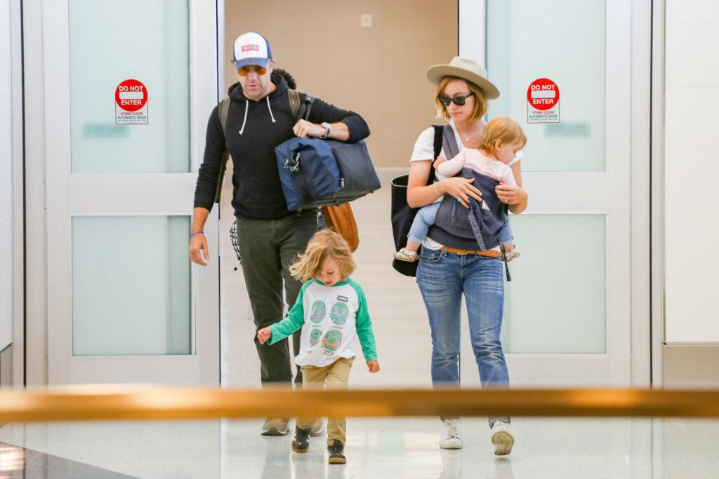 Olivia Wilde and Jason Sudeikis with kids at LAX International Airport