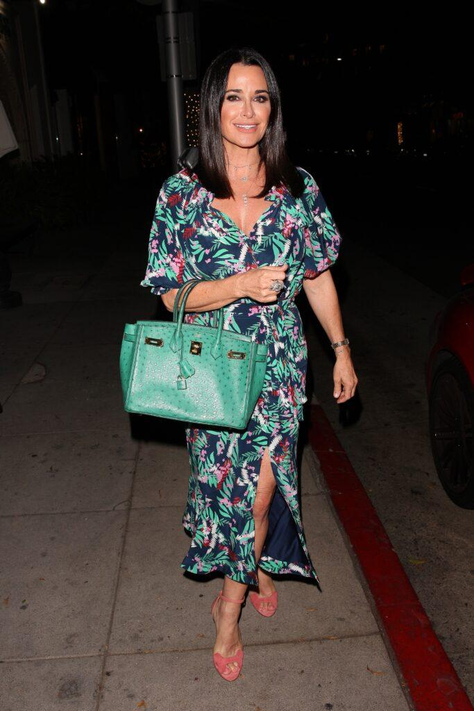 Kyle Richards looks stunning in a floral dress as she heads to Madeo Restaurant for dinner