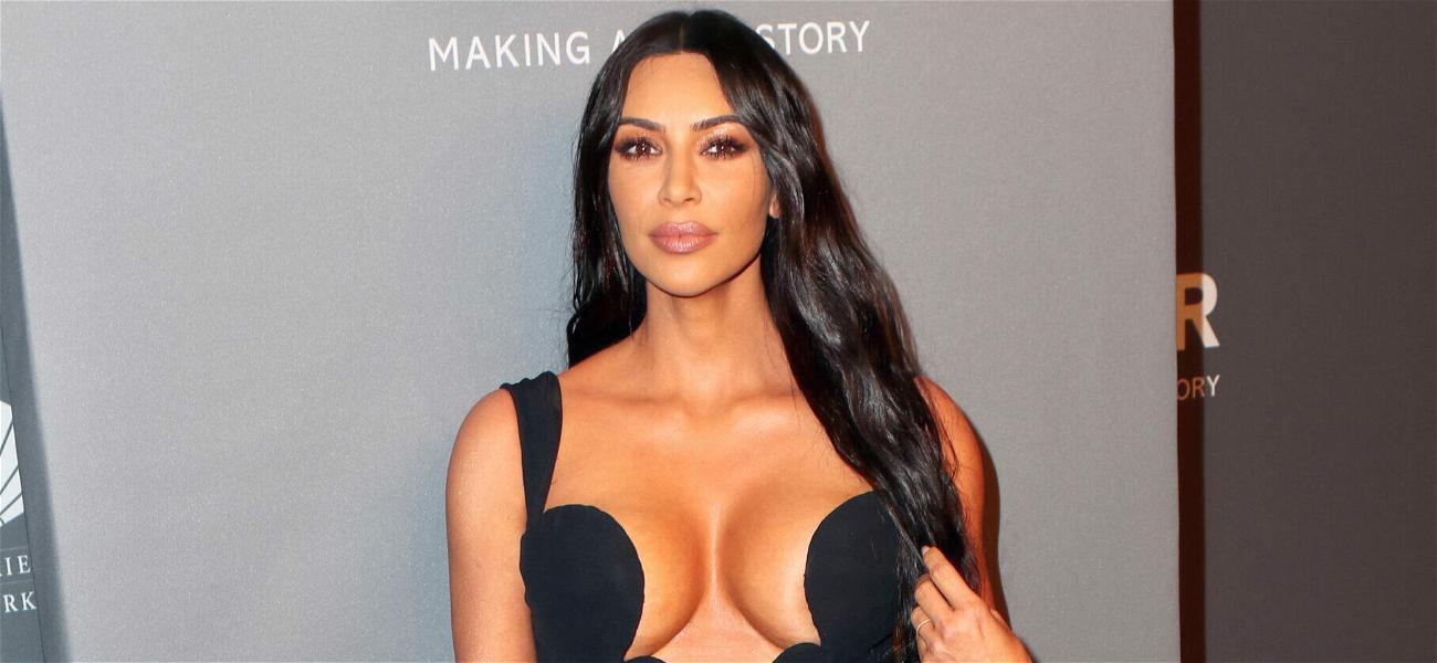 Kim Kardashian Flaunts Major Cleavage In Deeply Plunging Dress While Eating Pasta