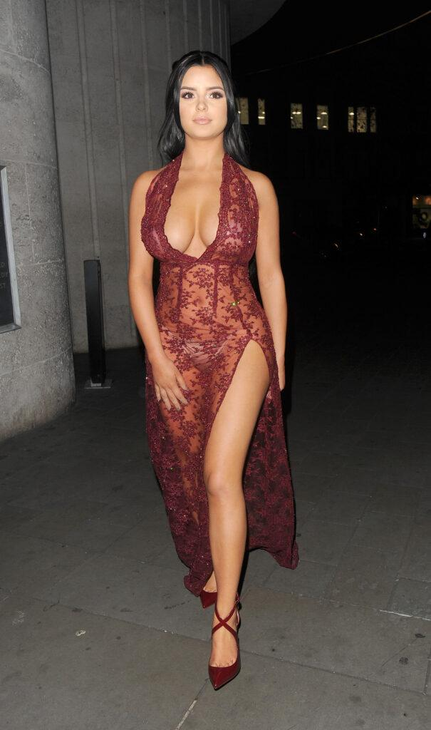Demi Rose Mawby leaving the ME Hotel wearing a stunning burgundy see through dress