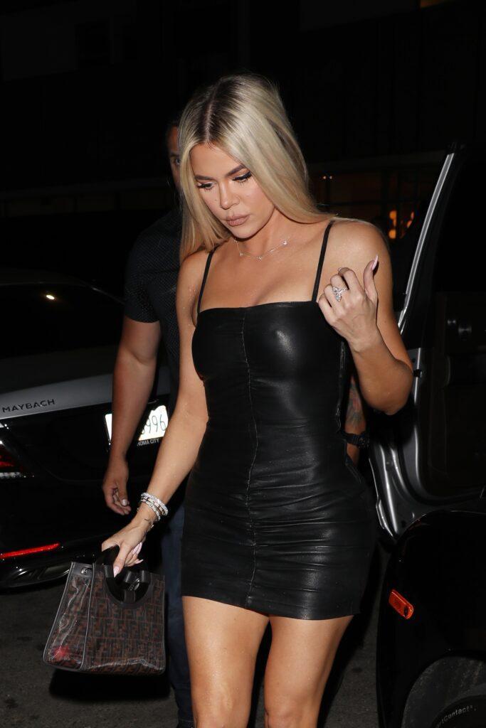 Khlo Kardashian wears a black leather dress as she goes to the Nice Guy restaurant