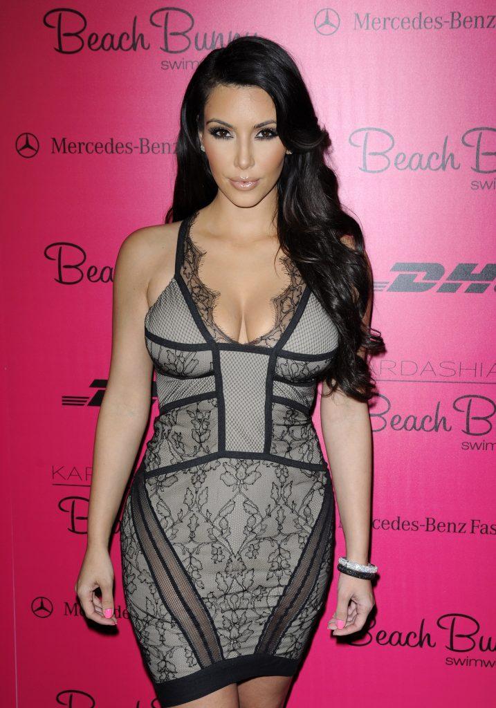 Kim Kardashian Khloe Kardashian and Kourtney Kardashian pose backstage Mercedes-Benz Fashionweek Swim 2011 in Miami Beach