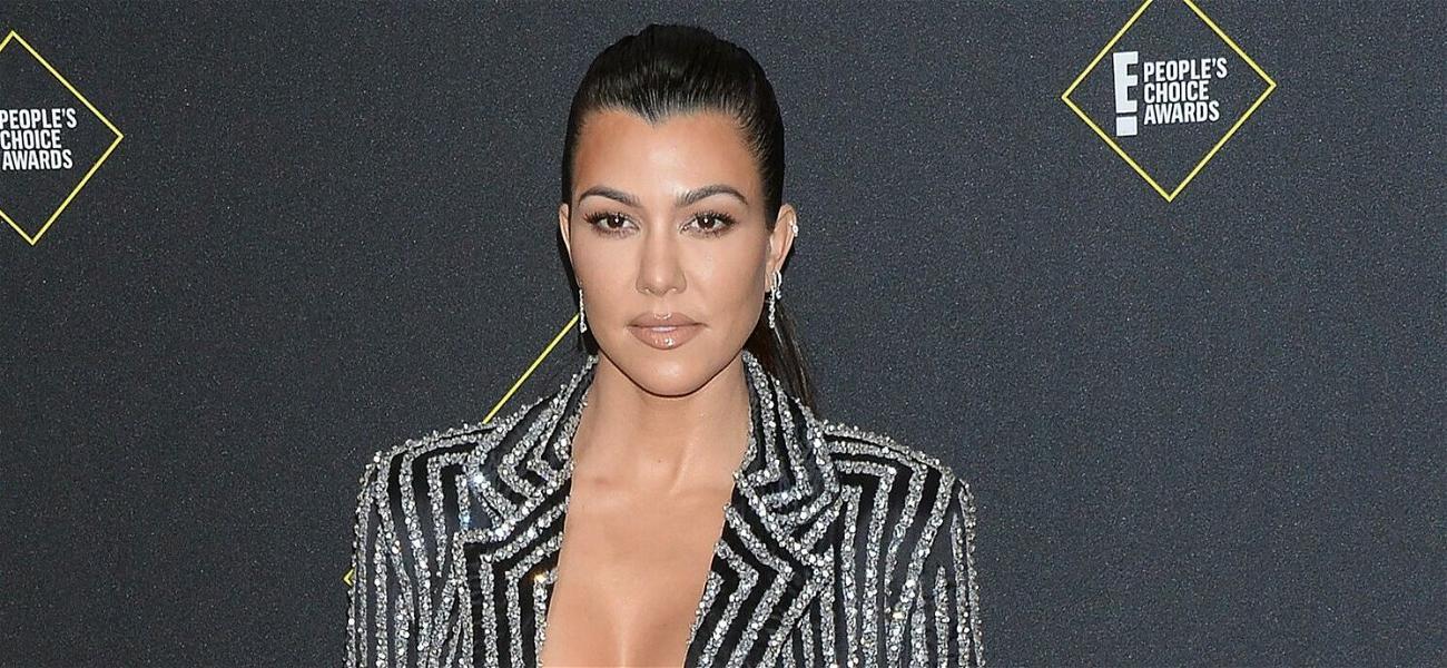 Kourtney Kardashian Sizzles In Tiny Bikini Top & Jeans While Basking Under The Sun