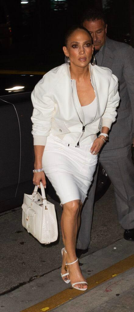 Jennifer Lopez looks chic in all-white as she goes for dinner in South Beach - before a cake was dropped on her lap