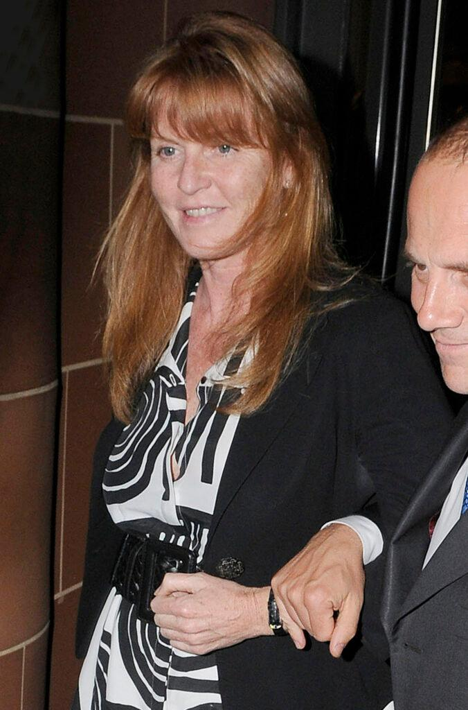 Sarah Ferguson Duchess of York is all smiles as she apos s greeted by around 30 photographers while leaving Cipriani restaurant in Mayfair at 1am She wore and black and white patterned dress and a black blazer