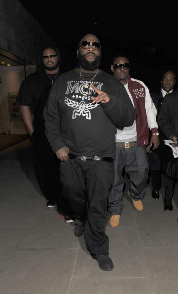 Rapper Rick Ross leaves the BBC Radio 1 studios wearing a sweatshirt with the slogan quot Money Controls Minds quot
