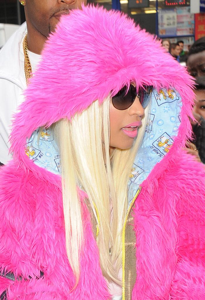 Nicki Minaj arriving at The W Hotel in Leicester Square wearing a pink furry hoodie black sweatpants with white stars on big white and black boots and holding a huge grey Louis Vuitton handbag