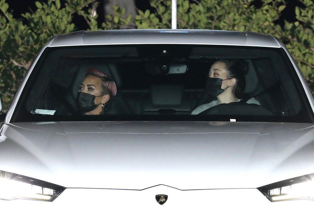 Singer Demi Lovato shows off her new short purple hair do as she and Noah Cyrus grab dinner at Nobu Malibu