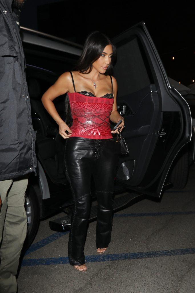 Kim Kardashian shows off her curves in a black leather pants and red snakeskin top as she heads to Jon amp Vinny apos s for dinner