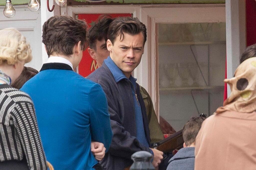 Harry Styles and Emma Corrin play fairground shooting games as they film My Policeman on Brighton Pier