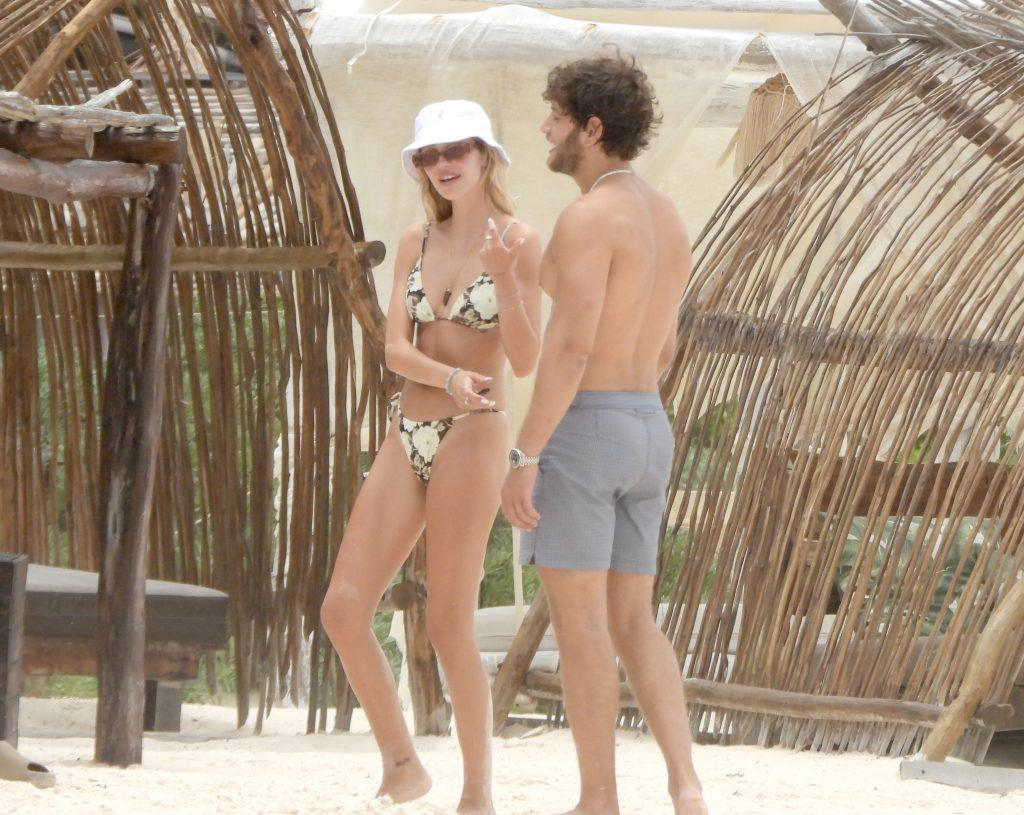 Delilah Hamlin kisses boyfriend Eyal Booker during a beach day in Mexico with her parents Lisa Rinna and Harry Hamlin