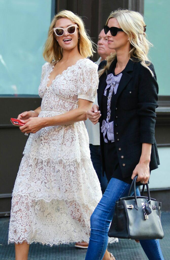 Paris Hilton and Nicky Hilton are all smiles as they make the streets of Soho their runway in NYC