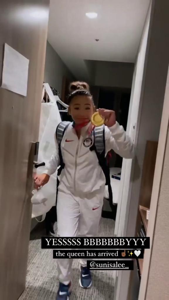 Sunisa Lee holding her gold medal.
