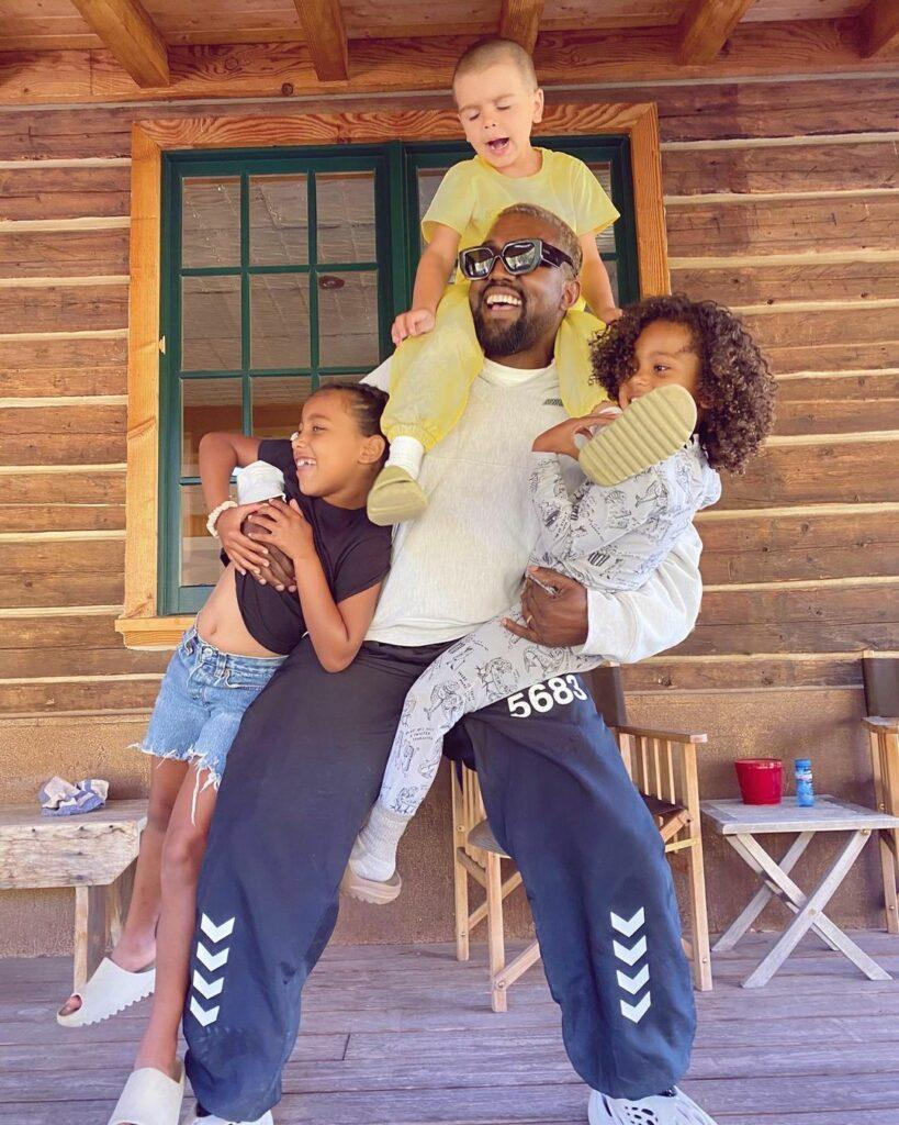 A photo showing Kanye West goofing around with his kids.