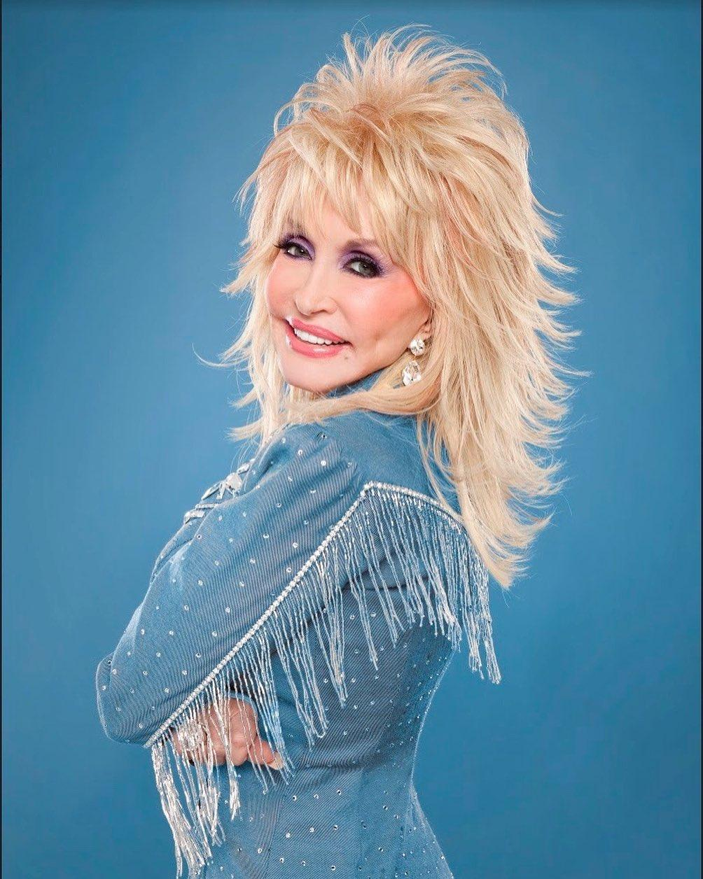 A photo of Dolly Parton in a blue outfit