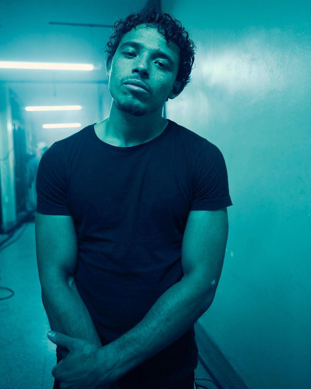 A photo of Anthony Ramos in a dark alley