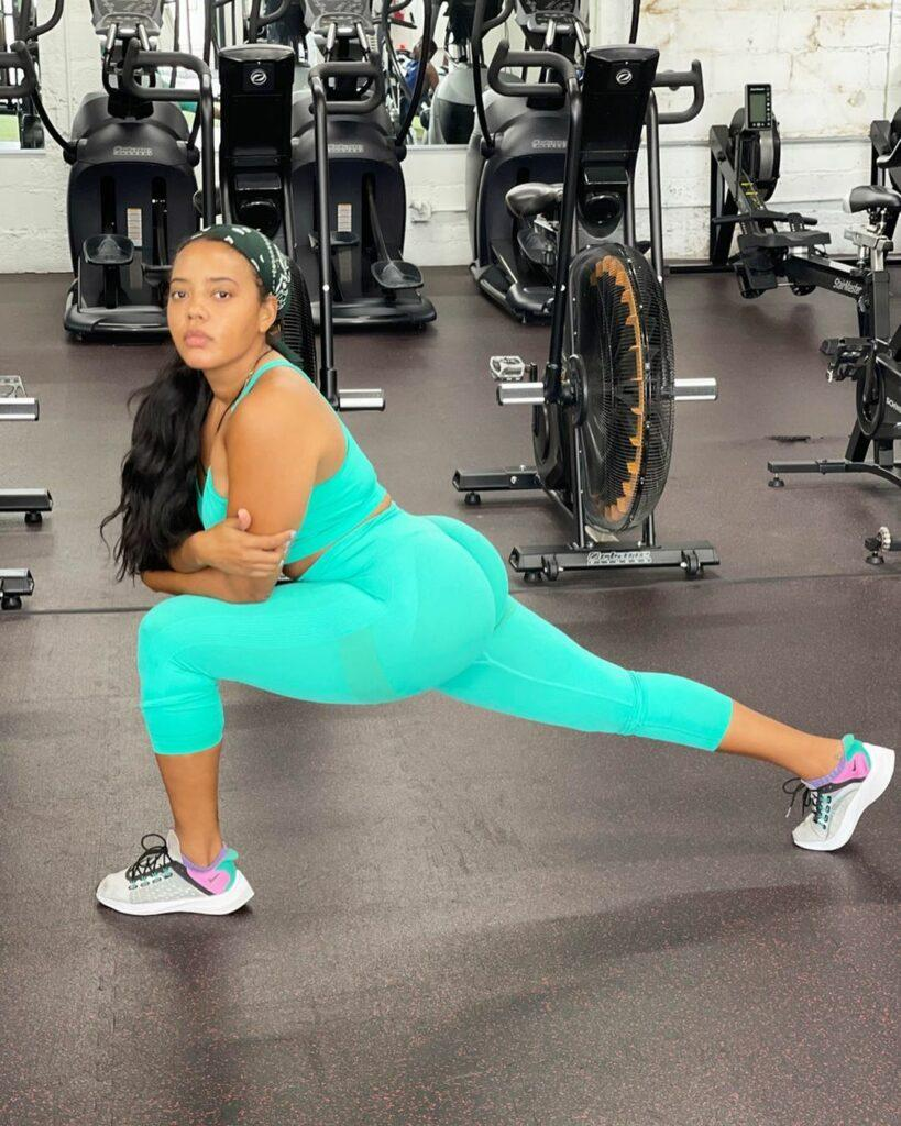 Angela Simmons doing a lunge.