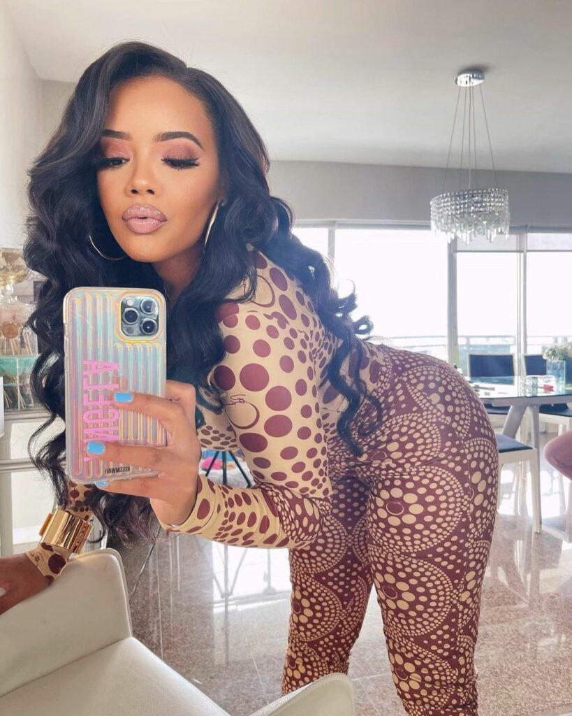 Angela Simmons in a brown bodysuit.