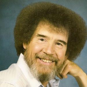 A photo showing Bob Ross with a huge smile on his face.