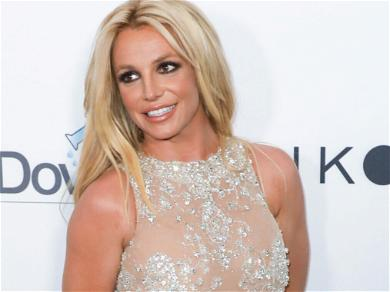 Britney Spears Shows Off Her 'Bite' While Spinning Around In A Yellow Crop Top