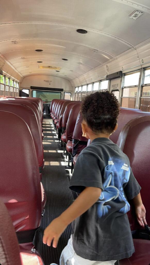 Stormi Webster inside an empty school bus.