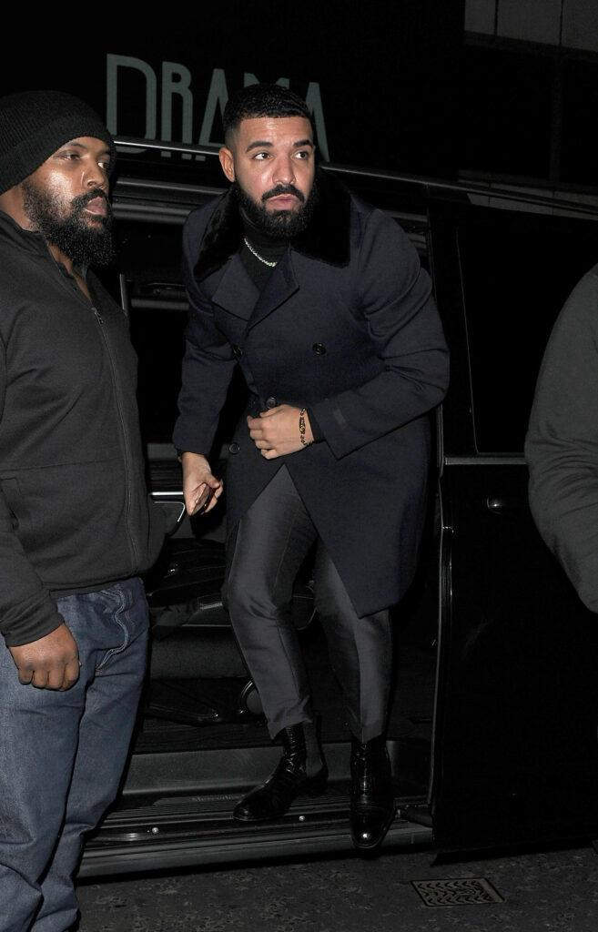 Drake seen arriving at The Colony Club Casino, flanked by minders..perhaps due to the recent spate of violent crimes being committed in the city