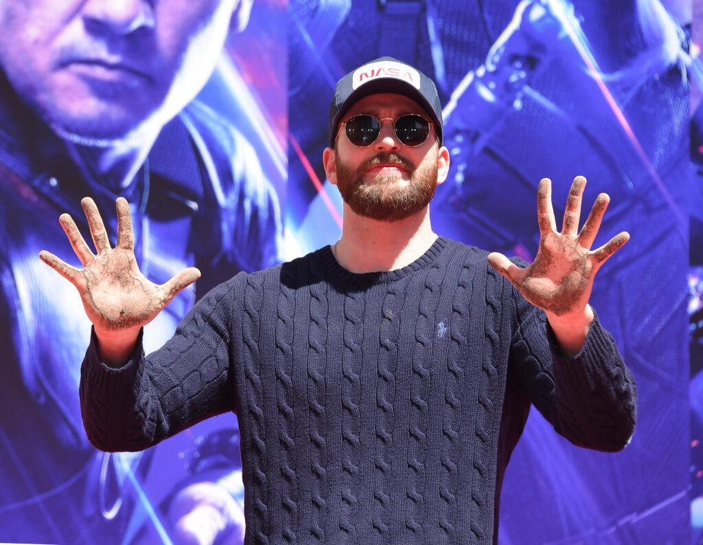 Chris Evans showing his palms