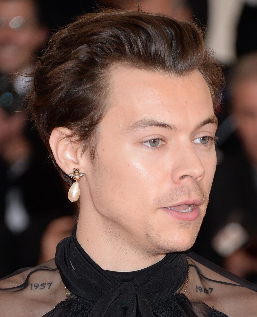 Harry Styles wearing a pearl earring